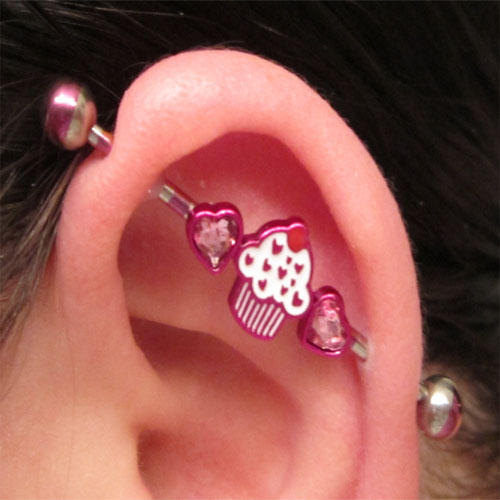 Steel pink striped industrial barbell with cupcake and gemmed hearts