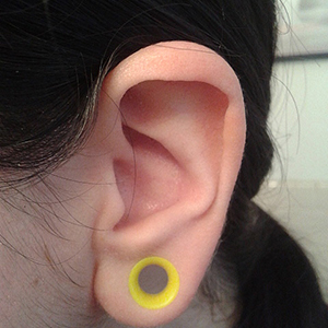 "Silicone earskin (UV yellow) 0g  (5/16"" wearable)"